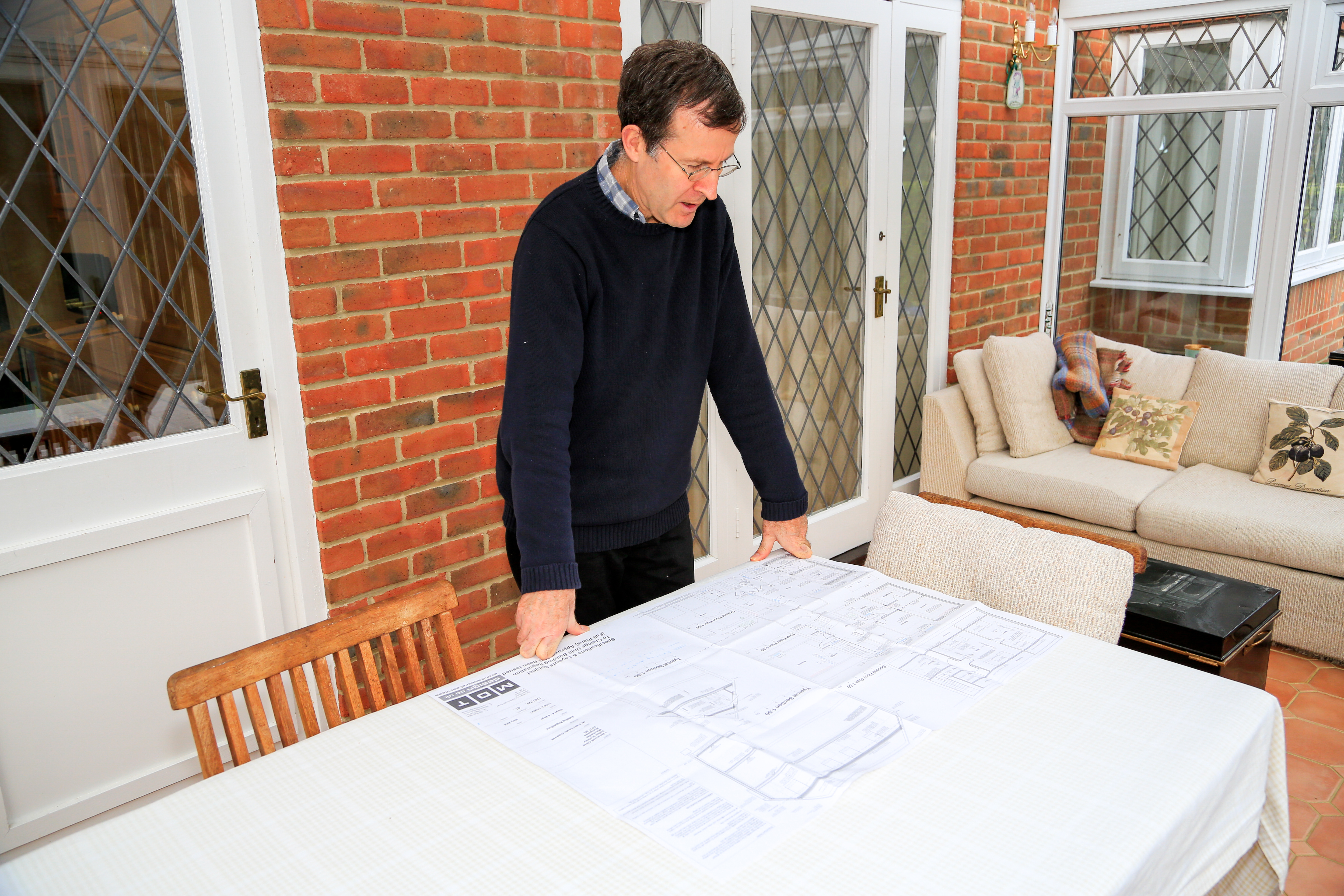 Architect drawing up plans