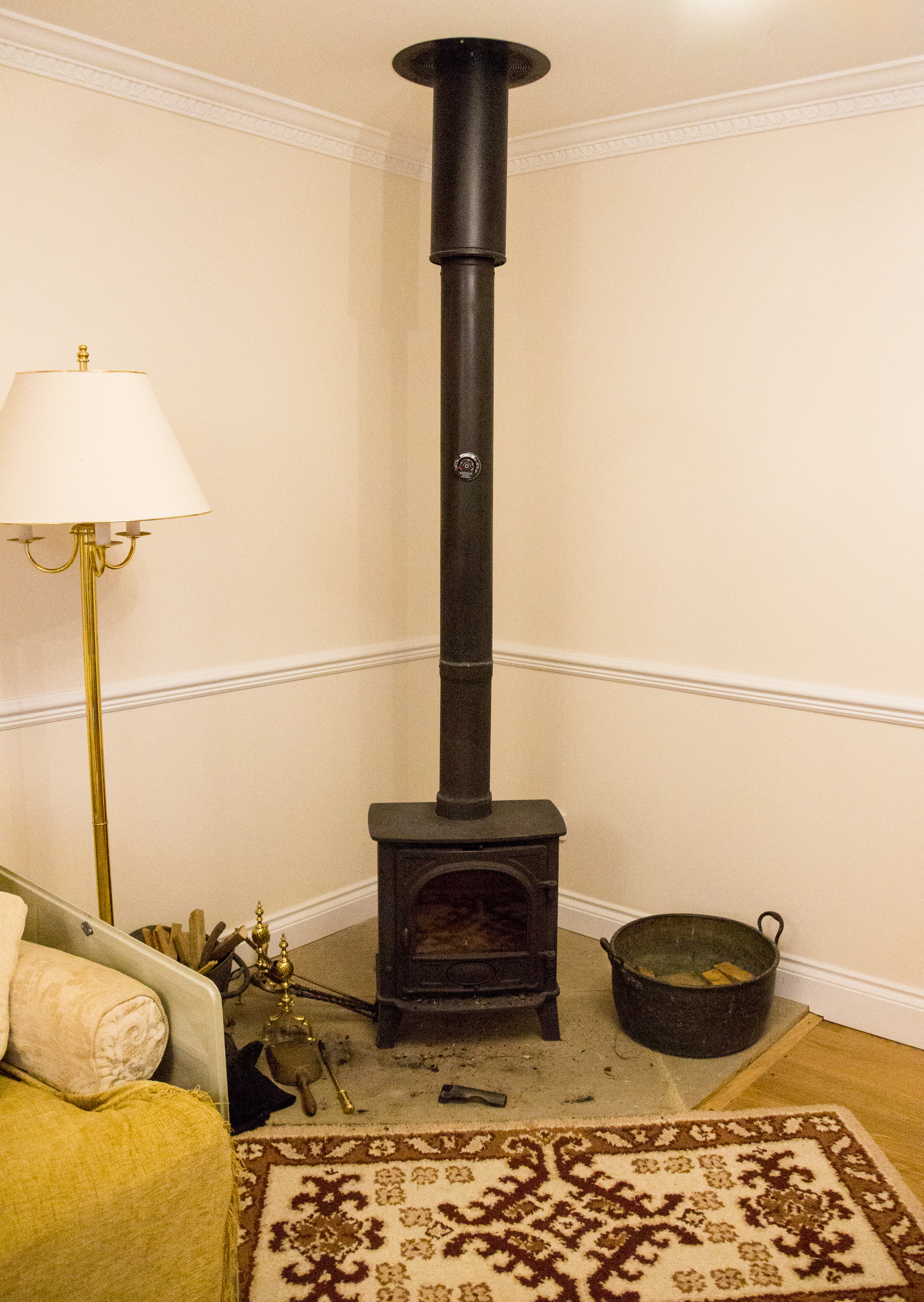 Wood burner installed in the corner of the room